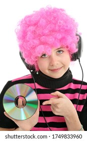 Young girl with pink hair and disk listening music,  isolated on white background