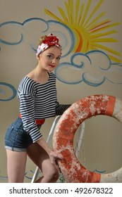 Young girl in pin-up image. A girl holding a life buoy.