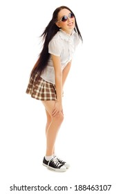 Young girl in plaid skirt isolated