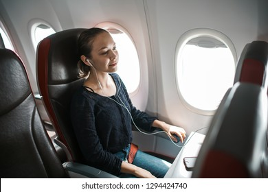 Young girl in plane