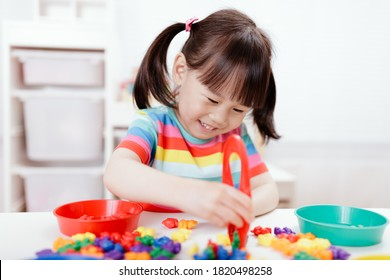 young girl play math and color sorting fine motor skill game for  homeschooling