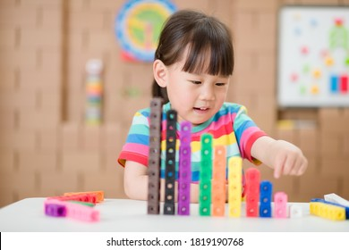 young girl play number sticks for homeschooling
