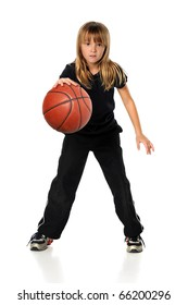 Young girl playing basketball isolated over white background