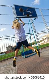 Young girl playing basketball outside