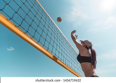 young girl playing beach volleyball. Outdoor sports games.