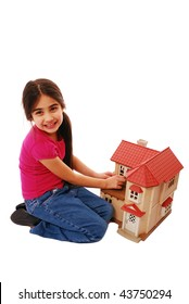 Young girl playing with dolls house isolated on white