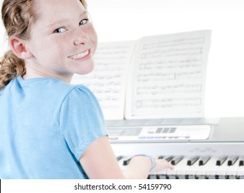 Young girl playing electric piano