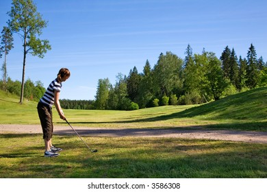 Young girl playing golf