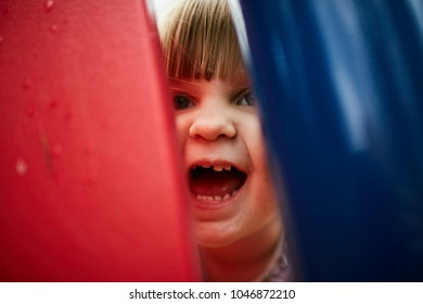 young girl playing hide and seek