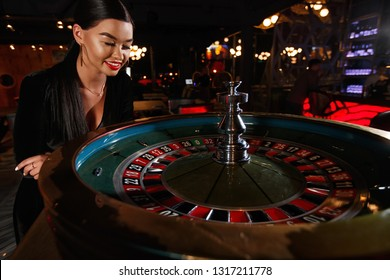 young girl playing roulette. selective focus