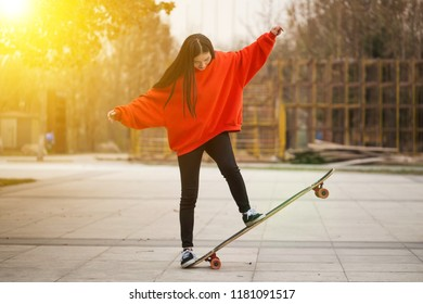 Young girl playing skateboarding, outdoor teen sport, concept