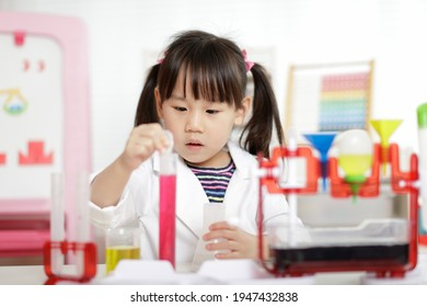young girl plays colour mixing science experiment for home schoo