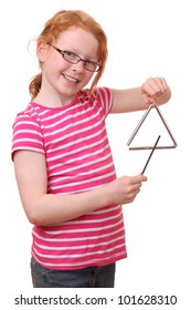 A young girl plays a triangle