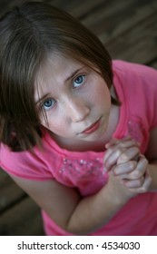 Young girl pleading or praying