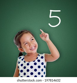 Young girl points finger with number five