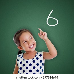 Young girl points finger with number six