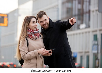 young girl points the way to a tourist