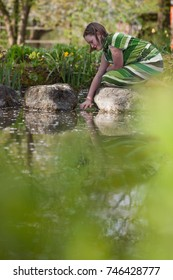 young girl at pond