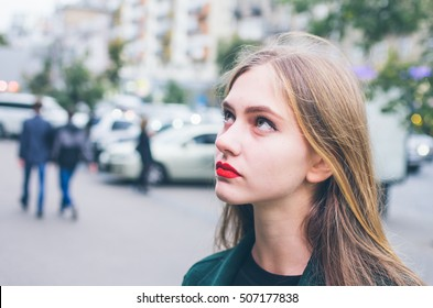 Young girl portrait against a city background