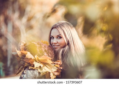 Young girl portrait in autumn forest