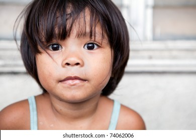 Young girl portrait in the Philippines. Filipina child living in poverty.