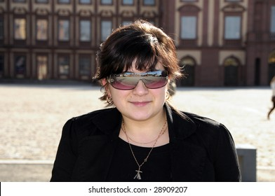 Young girl portrait with sunglasses reflecting