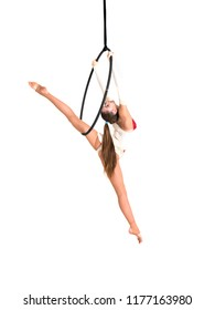 Young girl posing in an airy ring on a white background. Aerial hoop fly