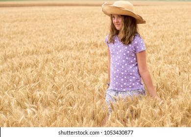 Young Girl posing in Barley Field