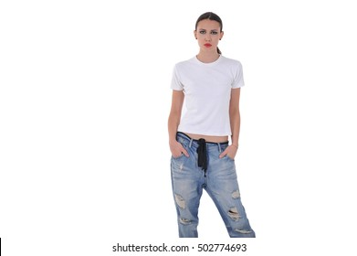 young girl posing in blue jean pant and white thsirt at studio
