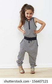 Young girl posing in jumpsuit, portrait