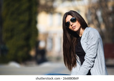 young girl posing on a background of the city