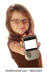 Young girl posing on isolated background holding a cell phone