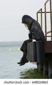 Young girl posing on pier at Lake Siutghiol