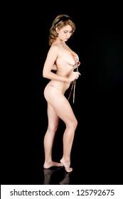 Young girl posing in a string bikini and untying her top