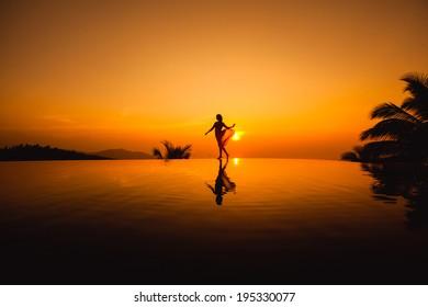 young girl posing at sunset