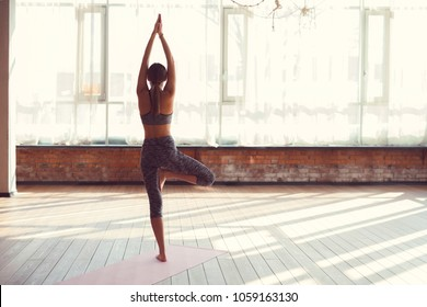 Young girl practicing yoga in yoga class