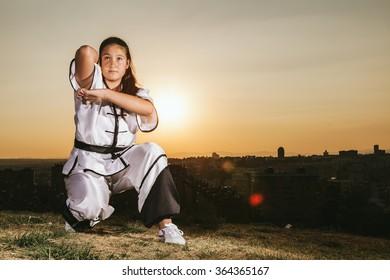 Young Girl Practising Wushu at Sunset