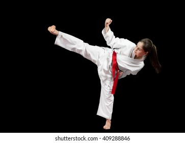 Young girl preforming karate martial arts.