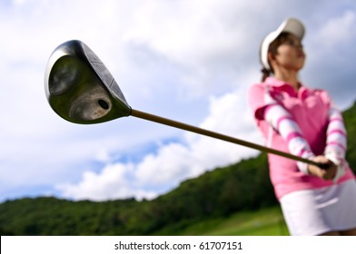 young girl preparation to drive golf