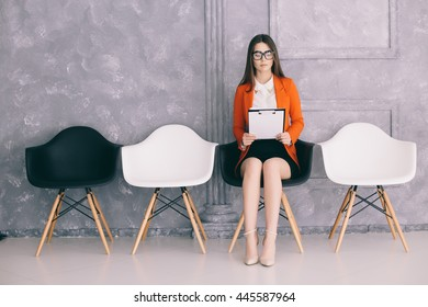 Young girl is preparing for first job interview in hall