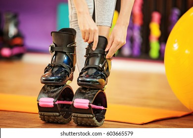 Young girl preparing for Kangoo Jumping training in the gym.