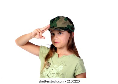 Young girl pretending to be an army recruit while standing at attention
