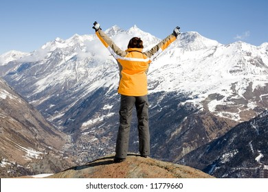 Young girl reached the top of the mountain