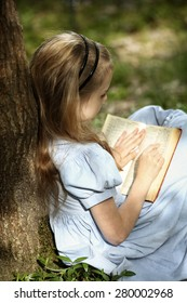 Young girl read book in nature scene