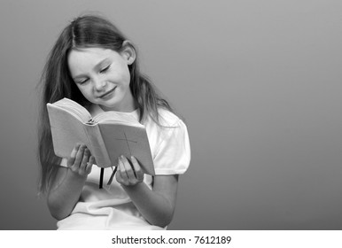 Young Girl Reading Bible