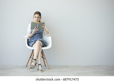 Young girl is reading book