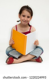 young girl reading a book isolated on white background