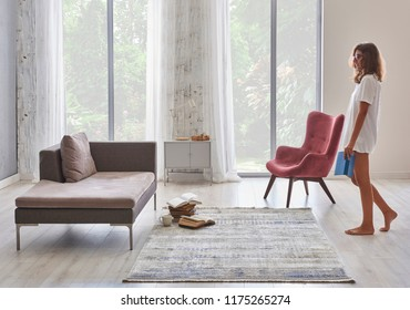 Young girl is reading a book in the modern home.