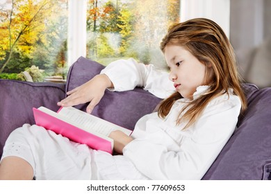 Young girl reading her book