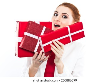 Young girl in red dress with gift red box. Beautiful red-haired girl on white.